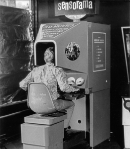 black and white image of man in Sensorama device